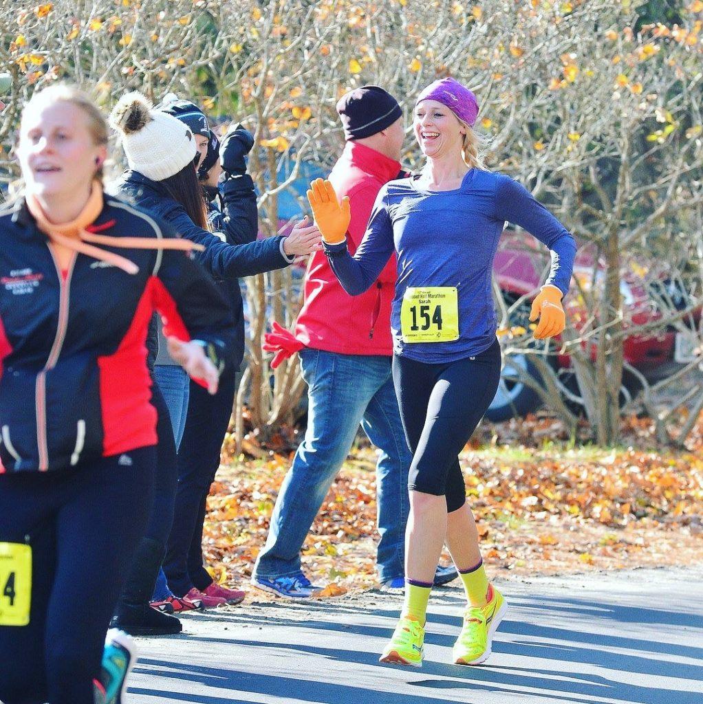 Sarah gets a high five at the Seacoast Half Marathon