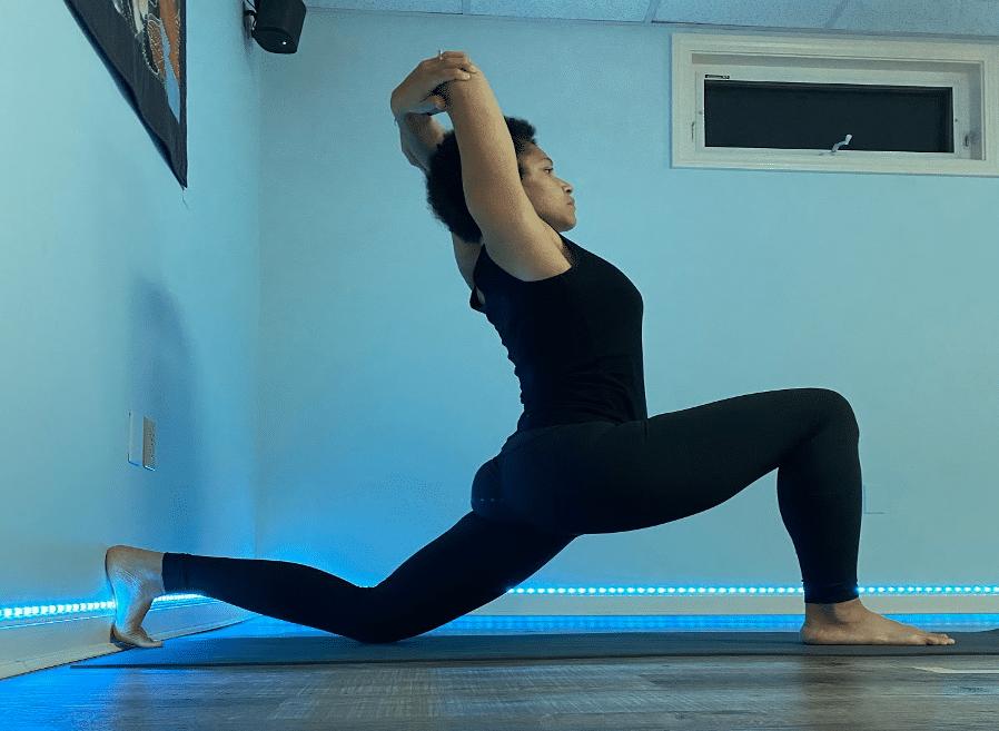 Sarah K in Knee Down at the Wall Yoga Pose