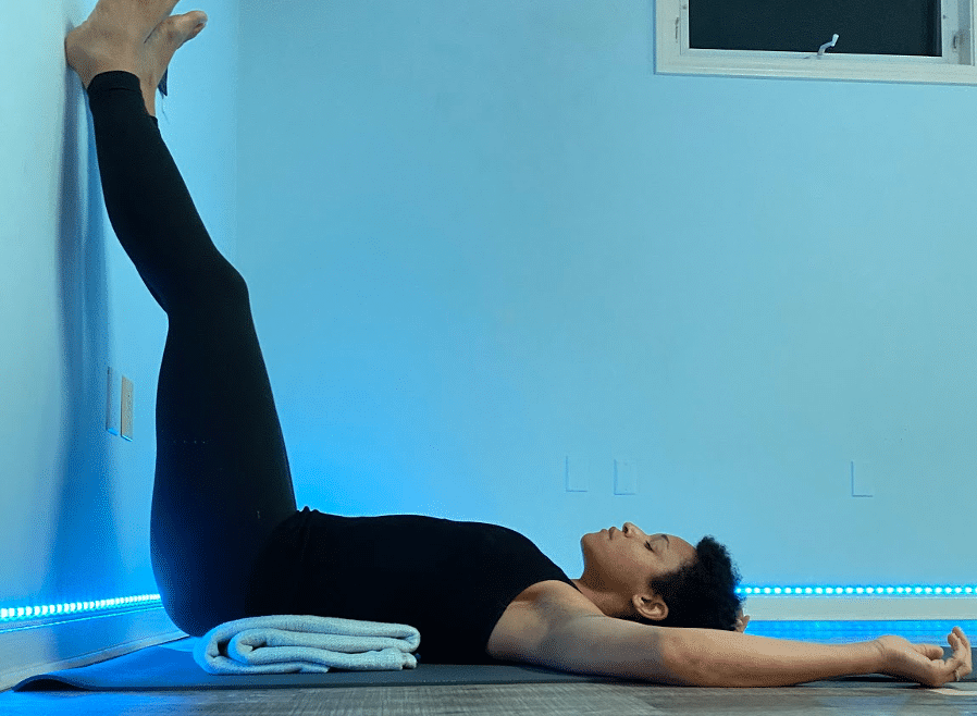 Sarah K in Legs up the Wall Yoga Pose