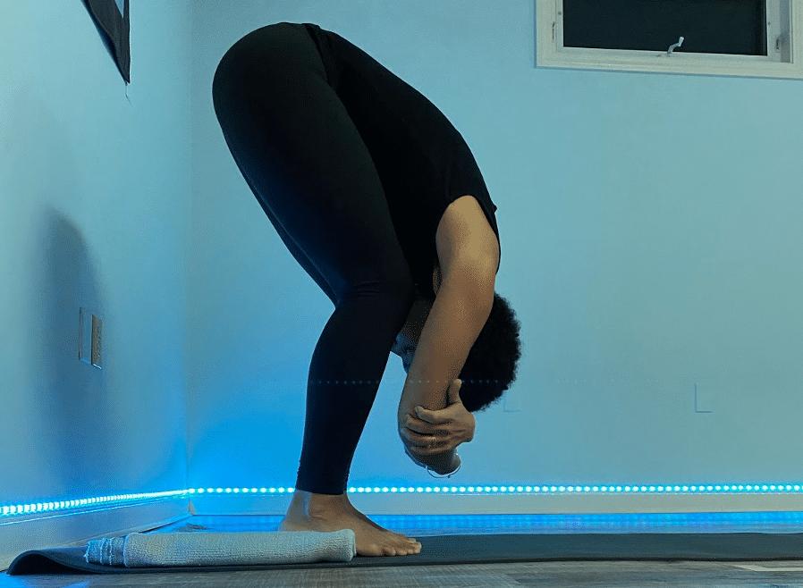 Sarah K. in Forward Fold Yoga Pose